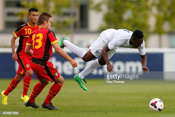 Tolaji Bola of England U16's in action with Natanael Frenoy of Belgium U16's during the International U16 fixture between England and Belgium at St...