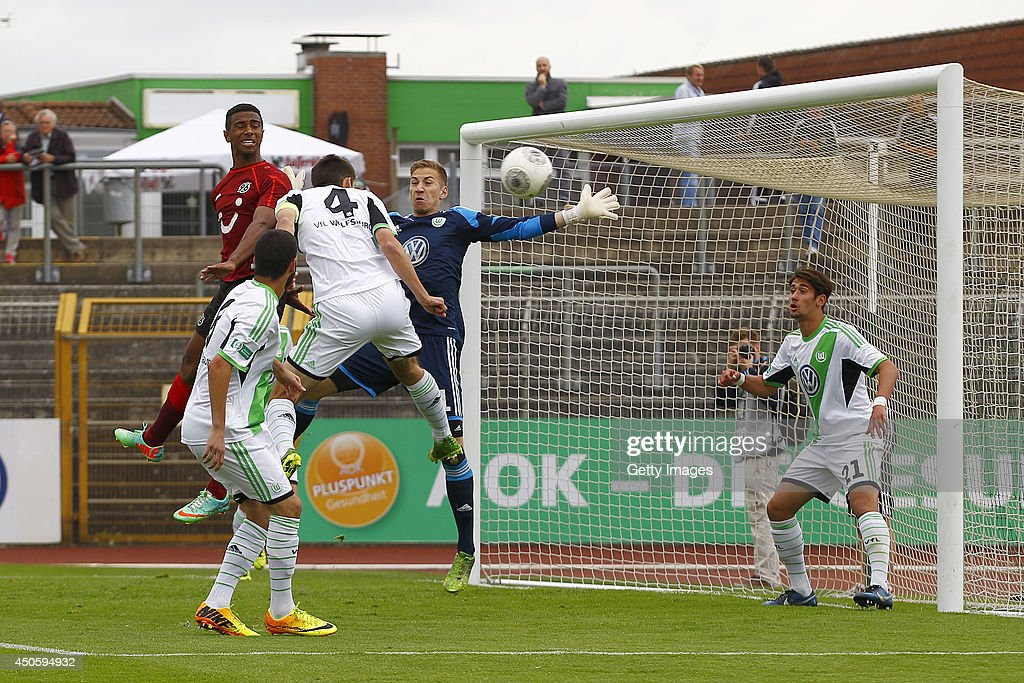 Tolcay Cigerci, Moritz Sprenger, Niklas Klinger of Wolfsburg challenges Noah Sarenren-Bazee of Hannover during the A Juniors Bundesliga Semi Final between U19 VfL Wolfsburg and U19 Hannover 96 at Stadion am Elsterweg on June 14, 2014 in Wolfsburg, Germany.