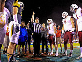 Toledo Rockets and Temple Owls players line up for the coin toss before the game at FAU Stadium on December 22 2015 in Boca Raton Florida