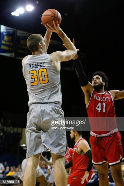Toledo Rockets forward Luke Knapke shoots over Ball State Cardinals center Trey Moses during a regular season basketball game between the Ball State...