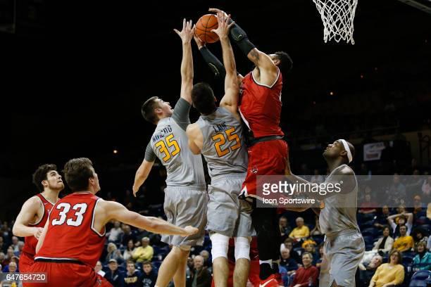 Toledo Rockets forward Nate Navigato and Toledo Rockets guard Jordan Lauf battles to grab a rebound over Ball State Cardinals forward Franko House...
