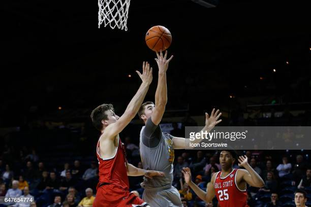 Toledo Rockets forward Nate Navigato goes in for a layup during a regular season basketball game between the Ball State Cardinals and the Toledo...