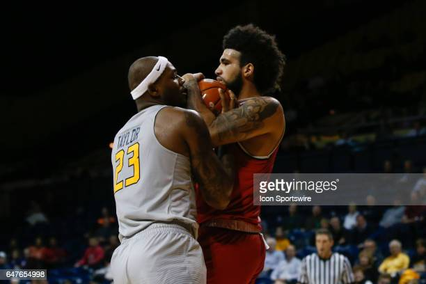 Toledo Rockets forward Steve Taylor Jr and Ball State Cardinals center Trey Moses battle to grab a rebound during a regular season basketball game...