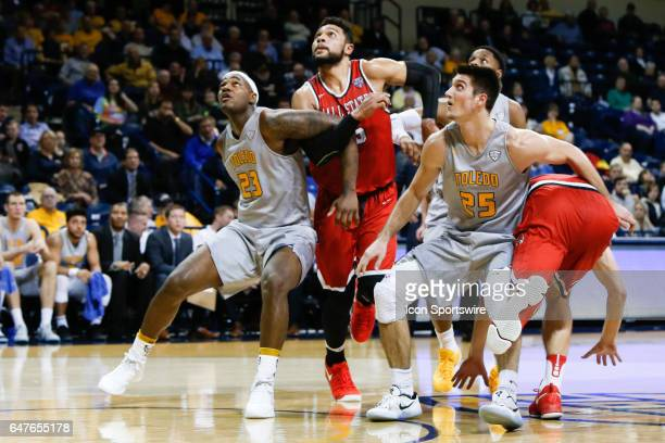 Toledo Rockets forward Steve Taylor Jr and Toledo Rockets guard Jordan Lauf battles for rebounding position against Ball State Cardinals forward...