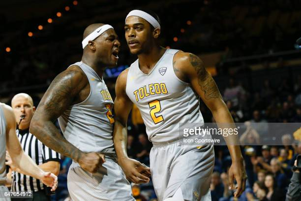 Toledo Rockets forward Steve Taylor Jr celebrates a play with teammate Toledo Rockets forward Taylor Adway during a regular season basketball game...