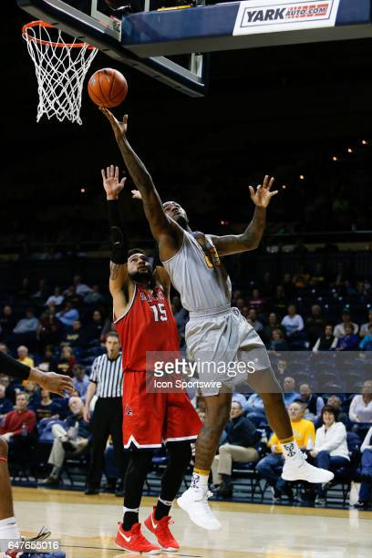 Toledo Rockets forward Steve Taylor Jr goes in for a layup against Ball State Cardinals forward Franko House during a regular season basketball game...