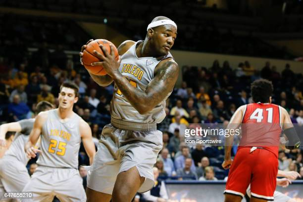 Toledo Rockets forward Steve Taylor Jr grabs a rebound during a regular season basketball game between the Ball State Cardinals and the Toledo...