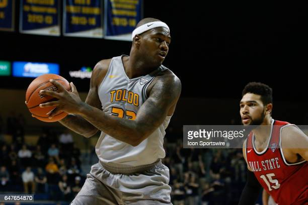 Toledo Rockets forward Steve Taylor Jr looks to pass the ball during a regular season basketball game between the Ball State Cardinals and the Toledo...