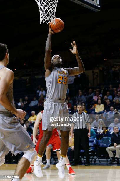 Toledo Rockets forward Steve Taylor Jr puts back a rebound during a regular season basketball game between the Ball State Cardinals and the Toledo...