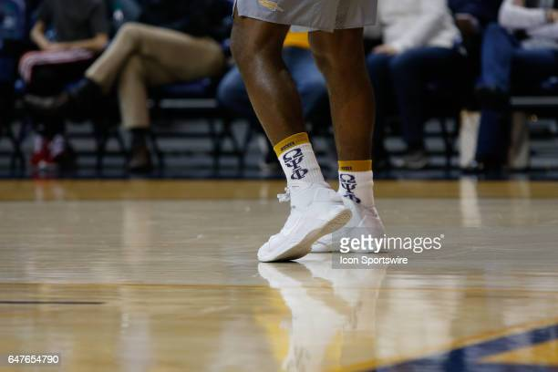 Toledo Rockets forward Steve Taylor Jr wears Greek fraternity socks during a regular season basketball game between the Ball State Cardinals and the...