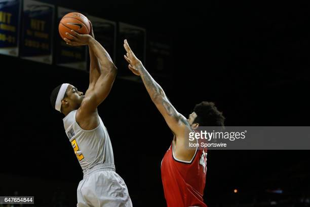 Toledo Rockets forward Taylor Adway shoots over Ball State Cardinals center Trey Moses during a regular season basketball game between the Ball State...