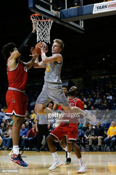 Toledo Rockets guard Jaelan Sanford drives to the basket against Ball State Cardinals center Trey Moses during a regular season basketball game...