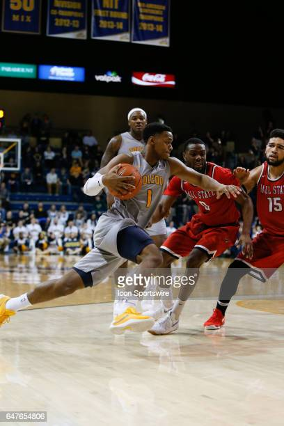 Toledo Rockets guard Jonathan Williams drives to the basket during a regular season basketball game between the Ball State Cardinals and the Toledo...
