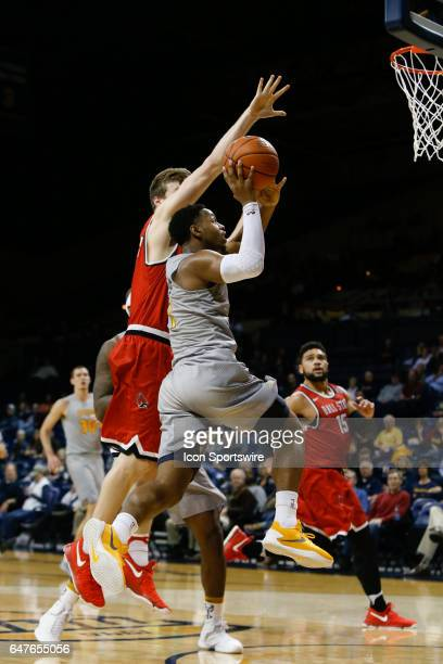 Toledo Rockets guard Jonathan Williams goes in for a layup during a regular season basketball game between the Ball State Cardinals and the Toledo...