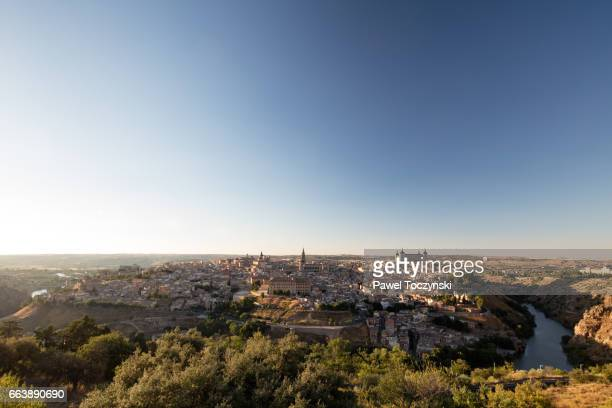 Toledo seen from across the bank of Rio Tajo on a summer afternoon, Spain