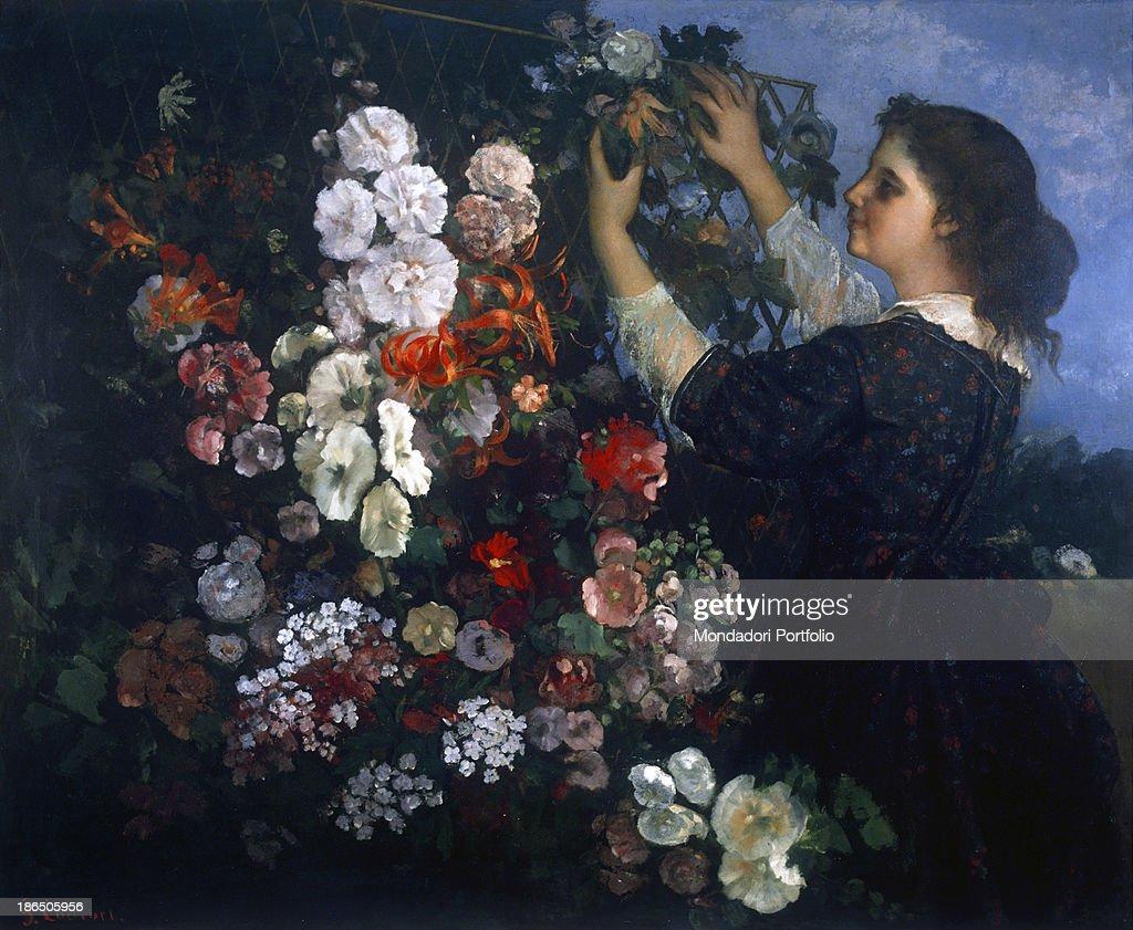 USA Toledo Toledo Museum of Art Whole artwork view A woman fixes flowers up a pergola