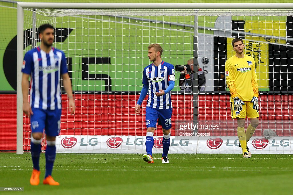 Tolga Cigerci, Fabian Lustenberger and Rune Jarstein of Berlin look dejected after the first goal of Leverkusen during the Bundesliga match between Bayer Leverkusen and Hertha BSC Berlin at BayArena on April 30, 2016 in Leverkusen, Germany.