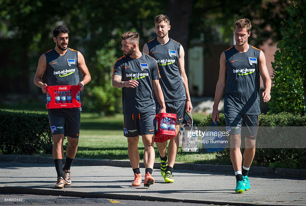 Tolga Cigerci, <a gi-track='captionPersonalityLinkClicked' href=/galleries/search?phrase=Marvin+Plattenhardt&family=editorial&specificpeople=5616506 ng-click='$event.stopPropagation()'>Marvin Plattenhardt</a>, Jens Hegeler, <a gi-track='captionPersonalityLinkClicked' href=/galleries/search?phrase=Sebastian+Langkamp&family=editorial&specificpeople=808587 ng-click='$event.stopPropagation()'>Sebastian Langkamp</a> of Hertha BSC during the training session at Schenkendorfplatz on July 01, 2016 in Berlin, Germany.