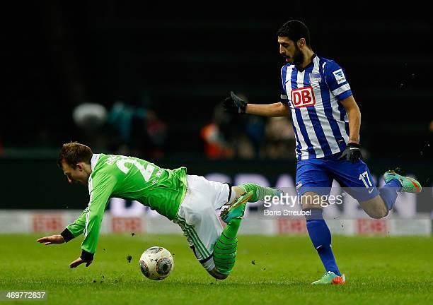 Tolga Cigerci of Berlin challenges Maximilian Arnold of Wolfsburg during the Bundesliga match between Hertha BSC and VfL Wolfsburg at Olympiastadion...