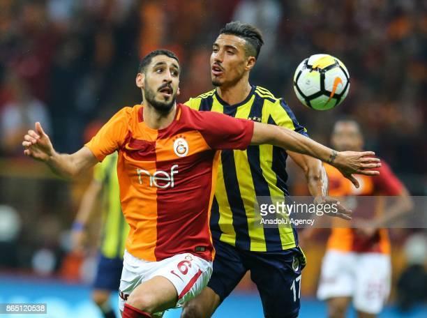 Tolga Cigerci of Galatasaray in action against Nabil Dirar of Fenerbahce during the Turkish Super Lig match between Galatasaray and Fenerbahce at Ali...