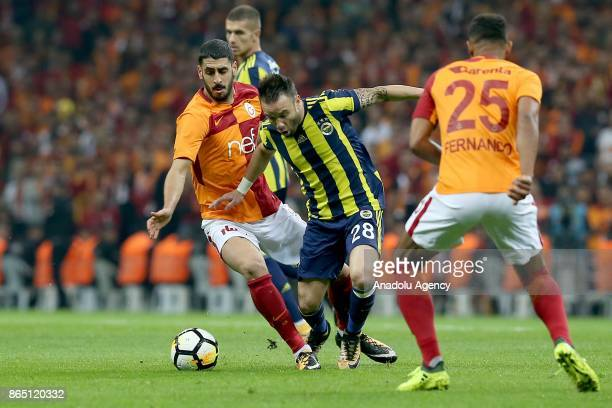 Tolga Cigerci of Galatasaray in action against Valbuena of Fenerbahce during a Turkish Super Lig match between Galatasaray and Fenerbahce at Ali Sami...