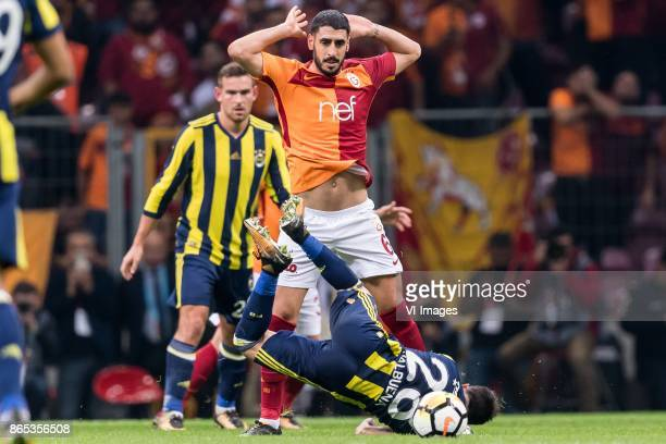 Tolga Cigerci of Galatasaray SK Mathieu Valbuena of Fenerbahce SK during the Turkish Spor Toto Super Lig football match between Galatasaray SK and...