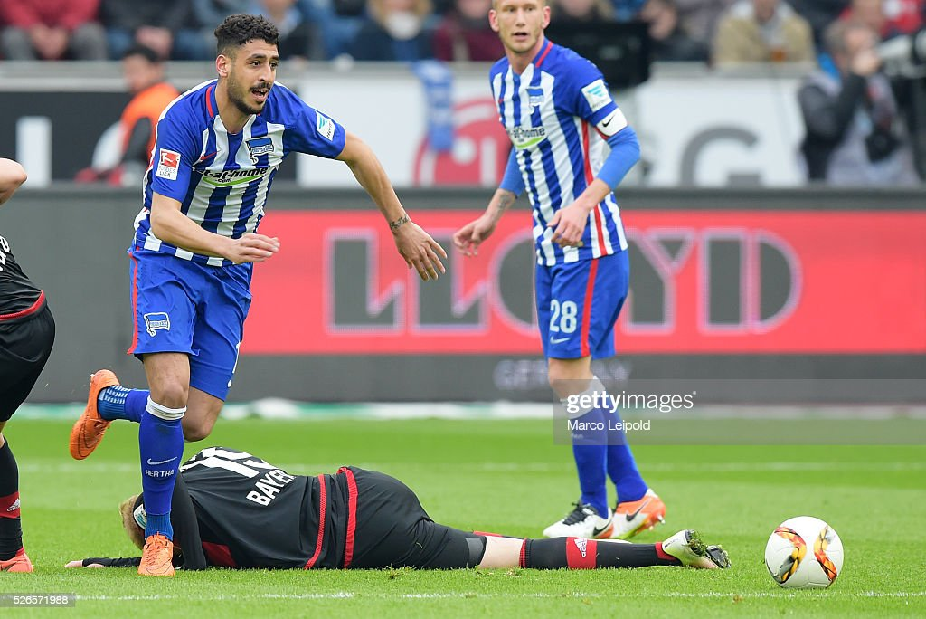 Tolga Cigerci of Hertha BSC and Julian Brandt of Bayer 04 Leverkusen during the game between Bayer 04 Leverkusen and Hertha BSC on april 30, 2016 in Leverkusen, Germany.