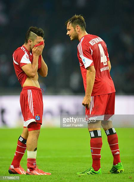 Tolgay Arslan and Heiko Westermann of Hamburg look dejected at the end of the Bundesliga match between Hertha BSC and Hamburger SV at Olympiastadion...