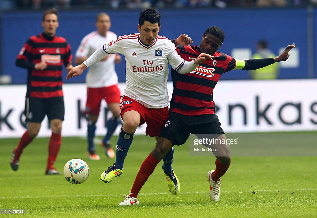 Tolgay Arslan (L) of Hamburg and Cedric Makiadi(R) of Freiburg battle for the ball during the Bundsliga match between Hamburger SV and SC Freiburg at Imtech Arena on March 17, 2012 in Hamburg, Germany.