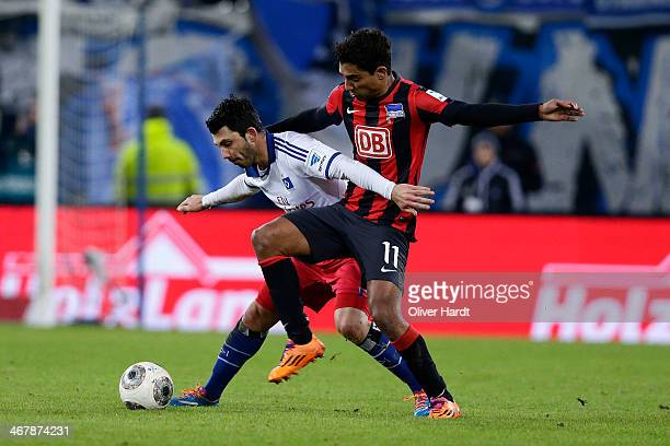 Tolgay Arslan of Hamburg and Sami Allagui of Berlin compete for the ball during the Bundesliga match between Hamburger SV and Hertha BSC at Imtech...