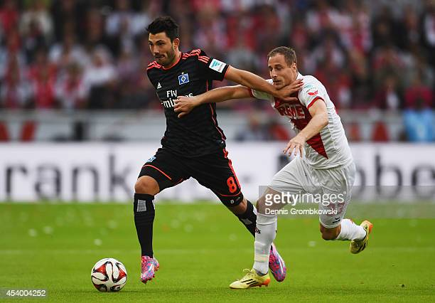 Tolgay Arslan of Hamburger SV and Matthias Lehmann of 1 FC Koeln battle for the ball during the Bundesliga match between 1 FC Koeln and Hamburger SV...