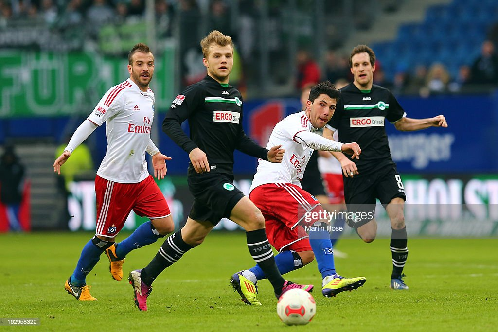Tolgay Arslan (c) of Hamburger SV is challenged by Johannes Geis of Greuther Fuerth during the Bundesliga match between Hamburger SV and Greuther Fuert at Imtech Arena on March 2, 2013 in Hamburg, Germany.