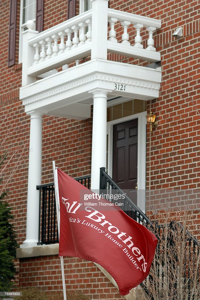 A Toll Brothers flag waves outside a model home in one of their developments February 22, 2007 in Buckingham, Pennsylvania. The home builder said profit dropped 67 percent in the first quarter due to a drop in the value of the company's land.
