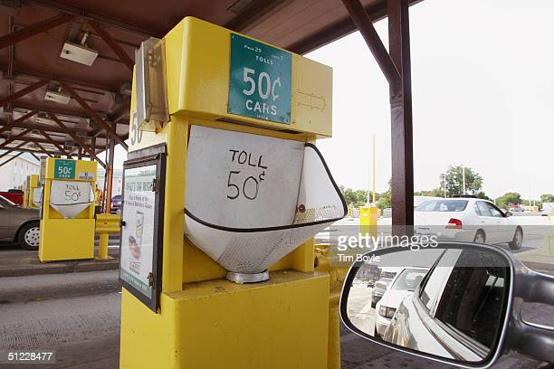 Toll collection machines are seen at an Illinois Tollway toll collection area August 27 2004 in Des Plaines Illinois Illinois Governor Rod R...