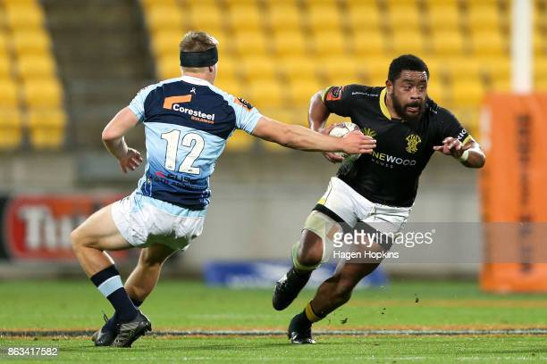Tolu Fahamokioa of Wellington beats the tackle of Jack Goodhue of Northland during the Mitre 10 Cup Semi Final match between Wellington and Northland...