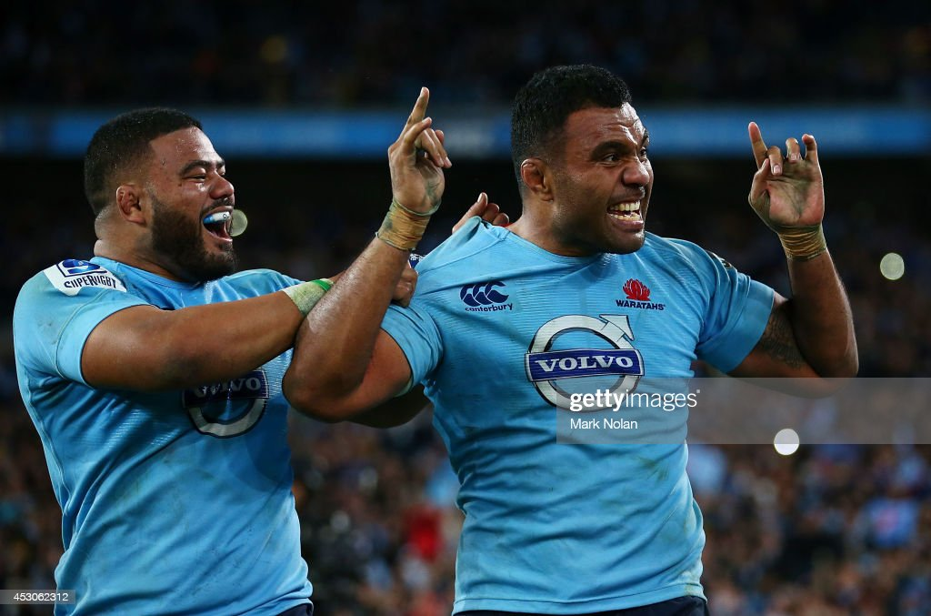 Tolu Latu and Wycliff Palu of the Waratahs celebrates winning the Super Rugby Grand Final match between the Waratahs and the Crusaders at ANZ Stadium on August 2, 2014 in Sydney, Australia.