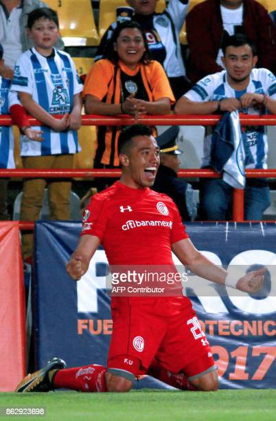 Toluca's Colombian player Fernando Uribe celebrates after scoring during the Mexican Apertura tournament match against Pachuca at the Hidalgo stadium...