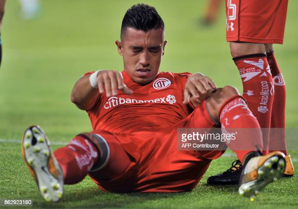 Toluca's Colombian player Fernando Uribe reacts during the Mexican Apertura tournament match against Pachuca at the Hidalgo stadium on October 18 in...