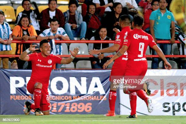 Toluca's Fernando Uribe celebrates with teammates after scoring against Pachuca during the Mexican Apertura tournament match at the Hidalgo stadium...