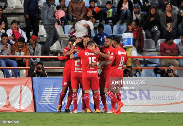 Toluca's footballers celebrate after scoring against Pachuca during the Mexican Apertura tournament match at the Hidalgo stadium on October 18 in...