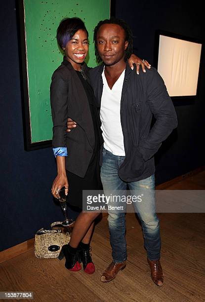 Tolula Adeyemi and Freddie Achom attend as Christie's and Vanity Fair host The Contemporary Art Party at Christie's King Street on October 10 2012 in...