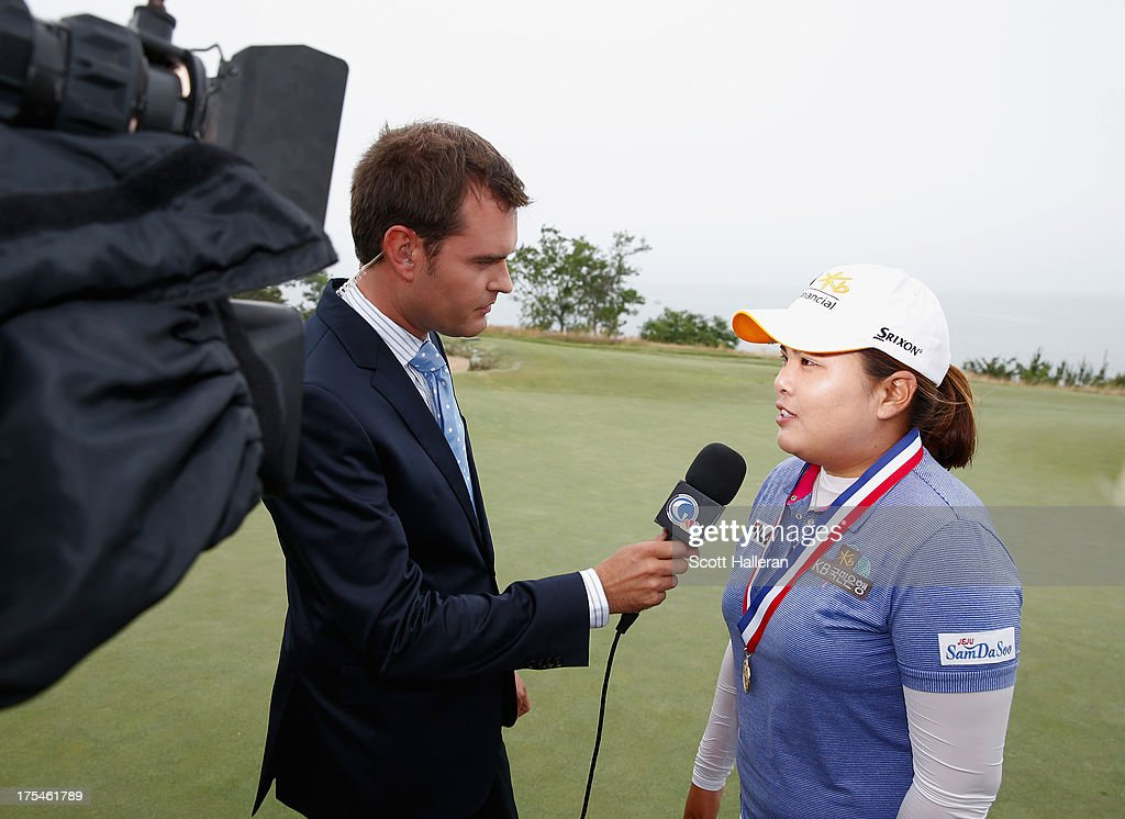 Tom Abbott of the Golf Channel interviews <a gi-track='captionPersonalityLinkClicked' href=/galleries/search?phrase=Inbee+Park&family=editorial&specificpeople=4532692 ng-click='$event.stopPropagation()'>Inbee Park</a> after the final round of the 2013 U.S. Women's Open at Sebonack Golf Club on June 30, 2013 in Southampton, New York.