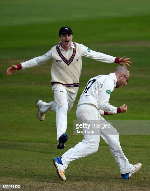 Tom Abell and Jack Leach of Somerset celebrate the wicket of Steven Finn of Middlesex and in doing so Somerset avoid relegation during Day Four of...