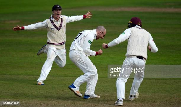 Tom Abell Jack Leach and George Bartlett of Somerset celebrate the wicket of Steven Finn of Middlesex and in doing so Somerset avoid relegation...