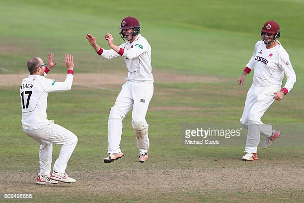 Tom Abell of Somerset celebrates after taking a catch off the bowling of Jack Leach to claim the wicket of Billy Root of Nottinghamshire during day...