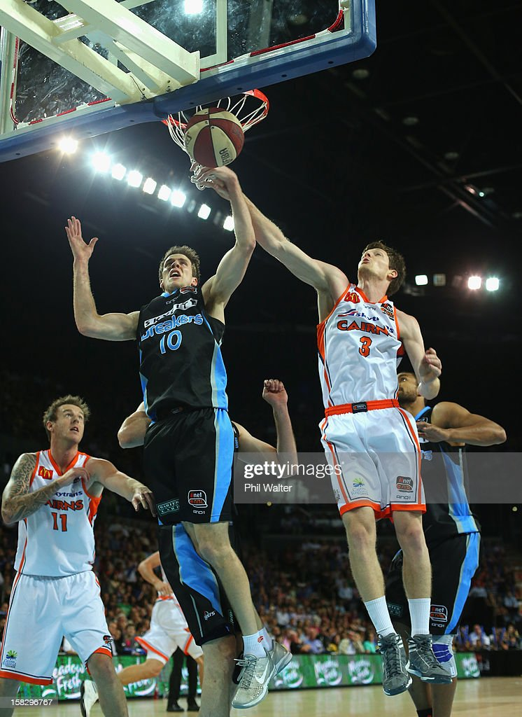 Tom Abercrombie of the Breakers (L) and Cam Gliddon of the Taipans (R) compete for the ball during the round 11 NBL match between the New Zealand Breakers and the Cairns Taipans at Vector Arena on December 13, 2012 in Auckland, New Zealand.