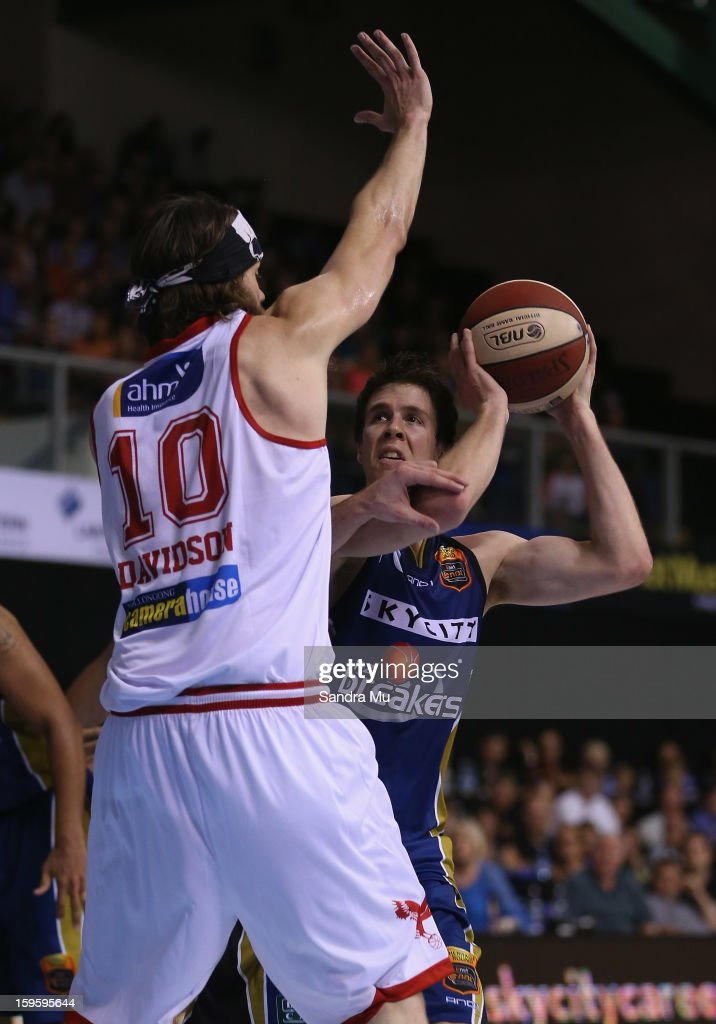 Tom Abercrombie of the Breakers looks to shoot past Larry Davidson of the Hawks during the round 15 NBL match between the New Zealand Breakers and the Wollongong Hawks at North Shore Events Centre on January 17, 2013 in Auckland, New Zealand.