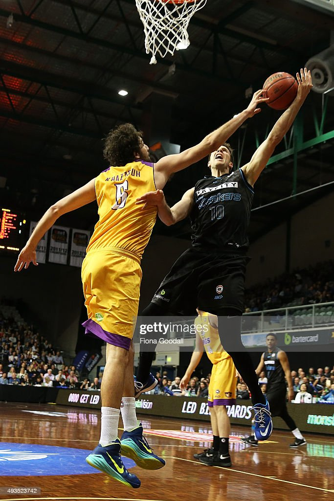 Tom Abercrombie (R) shoots for the Breakers with Kings defender Jason Cadee (L) during the round three NBL match between the New Zealand Breakers and the Sydney Kings at North Shore Events Centre on October 21, 2015 in Auckland, New Zealand.