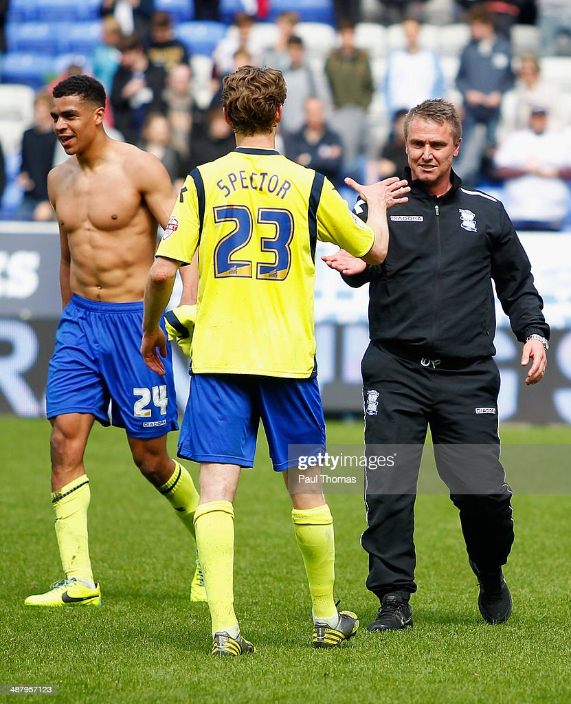 Tom Adeyemi and Jonathan Spector of Birmingham City celebrate with Lee Clark manager of Birmingham City as they avoid relegation after the Sky Bet Championship match between Bolton Wanderers and Birmingham City at Reebok Stadium on May 3, 2014 in Bolton, England.
