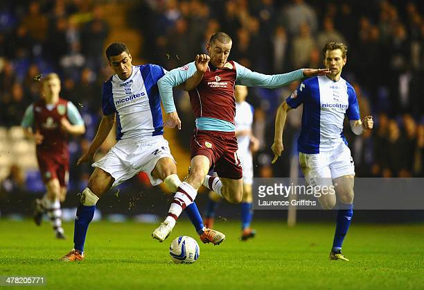 Tom Adeyemi of Birmingham City battles with David Jones of Burnley during the Sky Bet Championship match between Birmingham City and Burnley at St...
